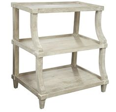 This reclaimed lumbar table features a light wood finish and a three tiered silhouette. This side table is the perfect height to be used as a nightstand. Add de