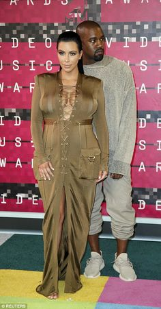 West announces he's running for president in 2020 Kim Kardashian and Kanye West.Kim Kardashian and Kanye West. Kim Kardashian And Kanye, Kardashian Style, Kardashian Jenner, Awkward Wedding Photos, Safari Dress, Mtv Video Music Award, Music Awards, Kim And Kanye, Iconic Dresses