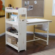 Sewing table- awesome idea with the fabric rolls attached to side- would be great for interfacings storage!