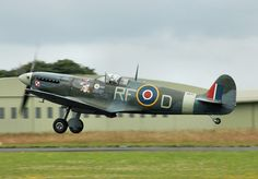 Spitfire AB910, built in 1941, painted in colours of Polish 303 Squadron. UK Battle of Britain Memorial Flight, Kemble Air Day 2009, Kemble, Gloucestershire, England.
