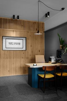 The redesign of East Ivanhoe Travel & Cruise was premised on creating an environment where general conceptions of the role of the travel agent in the digital age could be reset. The client delivers a dedicated, personal service for. Wood Slat Wall, Wood Slats, Wooden Walls, Corporate Interiors, Office Interiors, Office Entrance, Wood Trellis, Reception Design, Office Workspace