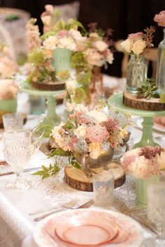 Love this tablescape.  And the best part is that we have the lace linens, jadite pedestal cake plates, mix and match jars and silver vessels all available to rent so you can recreate this look for your own wedding!  www.finchvintage.com #Centerpieces