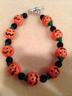 Hand Painted Glazed Halloween Orange Jack-O-Lantern Pumpkin & Onyx Faceted Bead Bracelet with Toggle Clasp https://www.etsy.com/listing/478208315/hand-painted-glazed-halloween-orange