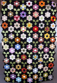 hexagon flowers on top of folded hexagons and jewels between.