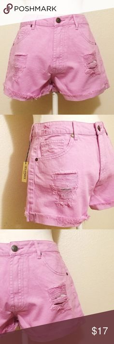 """💗Relaxed Fit Pretty, yet Destroyed Denim Shorts Relaxed Fit Destroyed Denim Shorts  - colour is between light lilac and pink. Did my best to get the colour accurate as possible.  - distressing on parts of waistband  - distressing on front shows pockets lining  - raw/frayed rolled hem    - 7.5"""" zipper length   -10.5"""" rise - runs true to size Lily Parker Shorts Jean Shorts"""