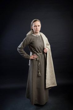 Casual woolen costume. Tunic sewn of thin natural light-gray cloth. Dress made of gray diagonal twill belt by sprang belt. Coatmade of coarse fabric.