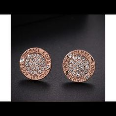 Michael Kors padlock Rosegold 1.3 cm studs Up for purchase is a lovely pair of Rose gold and rhinestones Michael Kors earrings studs 1.3 cm in diameter little bit smaller than add a dime. Huge 50% off sale for New Year's I have them in silver gold and Rosegold brand-new unused items. MICHAEL Michael Kors Jewelry Earrings