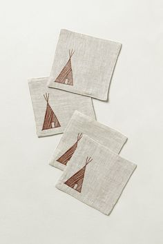 Linen Tee-Pee Coasters - Anthropologie.com. I am obsessed with coasters. Obsessed!
