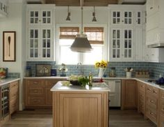 East Beach Kitchen by Mrs. Howard. Love the mix of wood and natural/calming ness of it's surroundings.  #cultivateit