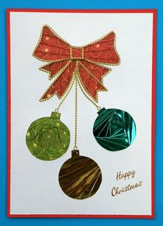 Three Round Christmas Baubles on Craftsuprint designed by Silvia Griffin - made by Suzi Cooper - Printed the sheet out then cut out and placed on a piece of white shimmer card and traced around the design. Completed iris folding using mirri papers and christmas papers. Attached to red card. Used gold peel off border as chains