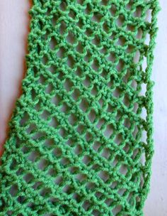 Fish net knitted scarf. I think I'm gonna use this to make a shrug. Will alter as I need. Love the stitch and pattern. Thanks for sharing.