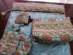 Organizadores de mala: porta escova de dentes, porta shampoo, porta lingerie e porta sabonete.