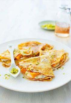 Ricotta filled crepes with mango, pistachio and rose syrup - really good.