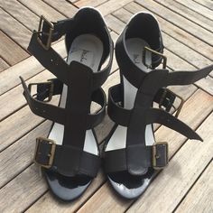 NEVER WORN! BLACK &WHITE HEELED SANDALS W/STRAPS Very confortable pair of THICK strapped sandals. Never worn. Kept in closet. Some blue scuff lines on the back. ***no trades*** don't forget to bundle for extra discount Michael Antonio Shoes Sandals