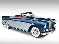 Talk about the apogee of old school cool. Vintage Rolls Royce drop.