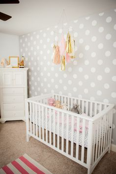 #polka-dots, #nursery, #mobile, #crib, #fringe, #wallpaper, #accent-wall, #gray, #neutral, #walls Photography: Katie Joyner Photography - www.katiejoynerphotography.com View entire slideshow: The Ultimate Nursery Round Up on http://www.stylemepretty.com/collection/190/