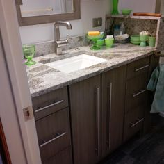 Custom Vanity with a Cambria Galloway Top, Kohler Memoirs Sink and Kohler Evoque Faucet. Caledon Tile Renovation