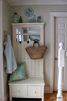 Style a HomeGoods hall tree cabinet with old glass bottles in one hue, a pretty pillow and a french market basket from HomeGoods for instant panache.
