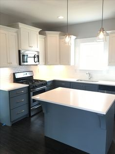 White Quartz kitchen cabinets paired with white upper cabinets and blue lower cabinets. Modern brass hardware and white subway tile backsplash. Upper Cabinets, Kitchen Cabinets, White Subway Tile Backsplash, Interior Design Work, Low Cabinet, New Home Builders, White Quartz, Brass Hardware, My Dream Home