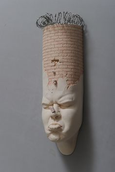 """Hong-based artist Johnson Tsang (previously featured here) bends, stretches and distorts human faces to create his impressive porcelain sculptures.  """"The comical works morph facial features and body parts, at times cramming the identities of multiple persons into a single being. These new pieces from his"""