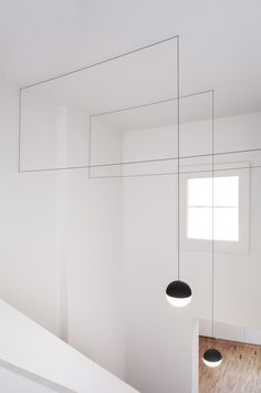 string lights for flos white walls wooden flooring