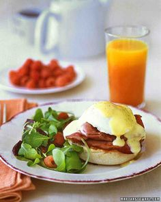 Eggs Benedict 1 tablespoon white vinegar  8 large eggs  Hollandaise Sauce  1/2 pound (16 slices) Canadian bacon  4 English muffins, Hollandaise Sauce 3 large egg yolks  Juice of 1 lemon  1 teaspoon salt  1/4 teaspoon white pepper  12 tablespoons (1 1/2 sticks) unsalted butter, melted and hot