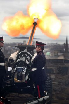 Gunners from 105th Regiment Royal Artillery firing a 21-Gun Royal Salute at Edinburgh Castle to mark the 64th anniversary of the Queen's accession to the throne.