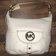 Michael Kors Fulton Vanilla Handbag NWT Michael Kors Genuine Leather Vanilla Fulton Large Shoulder Bag. Off-white pebbled leather with polished golden tone hardware and accents Lined interior with zippered pocket and (4) open slip pockets Fully zippered top closure; Small flap pocket on the front and open slip pocket on back Single shoulder strap with at least a 7 inch drop Measures approximately 14 inches (L) 11 inches (H) (at the center) x 3.5 inches (W) Michael Kors Bags Shoulder Bags