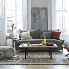 """Eclectic Style - I love the old """"distressed"""" french doors against the wall. I was going to do this in my bedroom (saw a perfect door set  in Valley Junction, W. Des Moines). Hmmmm...."""