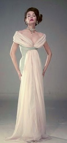 I love this idea of the scarf as the label of the dress, though this one is too long. I would have it stop at the waist (maybe sewn into waist band) 1954 Fashion