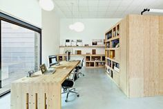 Minimalist Office Interior Design Combining Two Companies into One