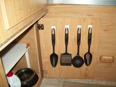 Add command hooks to the inside of your cabinets. | 44 Cheap And Easy Ways To Organize Your RV/Camper
