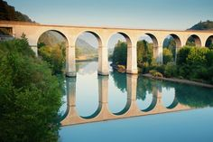 Early morning bridge reflection in the river Durance in Sisteron
