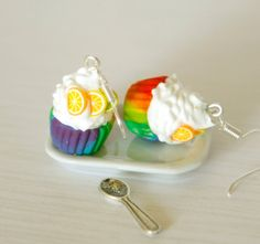 A pair of cute kawaii rainbow cupcake with clear fruit slices.   Dangle earrings made from polymer clay.  Charming dessert miniature, not edible but so