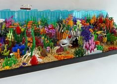 The Coral Reef and the Shark This set celebrates both – the incredible beauty of nature as well as the unbelievable versatility of Lego bricks. Shark Lego, Lego Fish, Lego Zoo, Lego Dinosaur, Lego Design, Lego Beach, Lego Craft, Minecraft Crafts, Lego Challenge