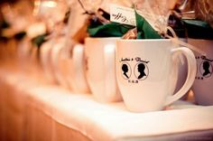 Great idea for a wedding favor. I'd probably have three different styles of mugs though. (: