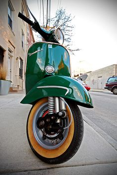 Low Angled Shot of a Green Vespa.