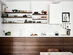 white square angled tile + wood cabinets + open shelving