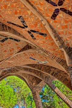one of the buildings that form the colonia güell, it is considered by many as a singular workshop where gaudi practiced solutions that were later applied to the hugely famous sagrada familia.