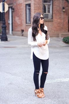 Long white silk blouse and distressed jeans