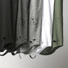 """@KNYEW """"Distressed E-Long Scoop Tees + Tanks""""   Releasing in-store + online this Friday, June 26th   #KNYEW"""