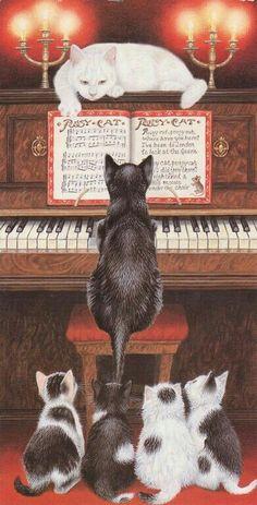 famiglia di gatti al pianoforte