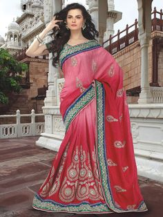 Look and feel gorgeous in this beautiful lehenga saree. The saree is red in color and is made of viscos material and is a perfect party wear. It has heavy stone work all over and has stone designer motifs on the pallu. The contrasting green border with heavy work enhances the look of it. (Slight variation in color is possible)