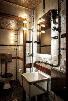 We handcrafted all the iron pipework including the taps, sourced edison style globes, vintage basins, vintage cisterns and new Bakelite toilet seats. Description from recycledinteriors.org. I searched for this on bing.com/images