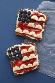 Yummy cream cheese covered toast with  strawberry jam, blueberries and bananas.