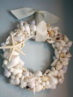 """Here is another fun summer project that you can do by yourself or with your kids. It is the easiest project under the sun: a seashell wreath that is sure to make a summery beach splash right to your home.   16"""" foam wreath ring (you can use one by..."""