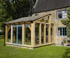 Garden room addition Oak timber framed conservatories can make a stylish a. Orangerie Extension, Porch Extension, Cottage Extension, Glass Extension, Garden Room Extensions, House Extensions, House With Porch, House Front, Lean To Conservatory