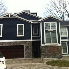 Blue house with dry stacked stone and dark wood Dark Blue Houses, Navy Houses, Grey House White Trim, Black House, Small Basement Remodel, Basement Remodeling, Basement Plans, House Paint Exterior, Exterior House Colors
