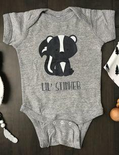 Lil' Stinker Onesie | Skunk Onesie | Stinky Baby | Lil' Rascal Onesie | Newborn Baby Bodysuit | Cute Skink | Funny Baby Onesie #babyonesie #babyshower #babyshowergifts #woodlandbabyshower #woodlandbabytheme