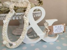 Wooden Horseshoe & Ampersand Letter Painted in Bone China Chalk Paint with Luggage Tag Decorated with Cabachons & Flatbacks Pearls to Match Wedding Colours. Tag can be printed with any good luck message, names, wedding or anniversary date etc. Perfect for Top Table, Sweet Table, Wedding Gift, Keepsake. For full range see www.facebook.com/bowsandbowsclips
